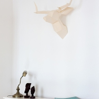 A paper deer on the wall